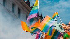 Multiple Hands Waving Pride Flags