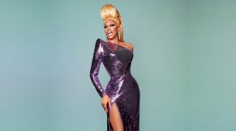 Rupaul Charles Wearing a Long, Sparkly Purple Dress