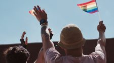 Two People holding Pride Flags