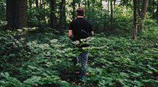 Man walking through forest